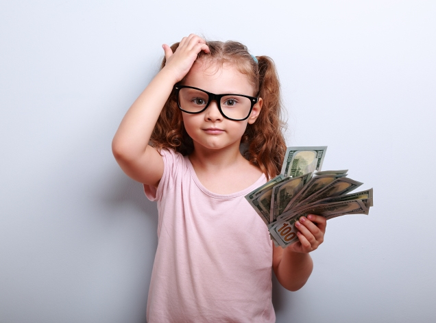 Small professor in eye glasses scratching head, holding money